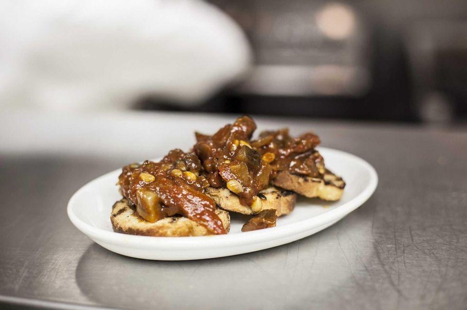 Vero's melanzane bruschetta appetizer is topped with an