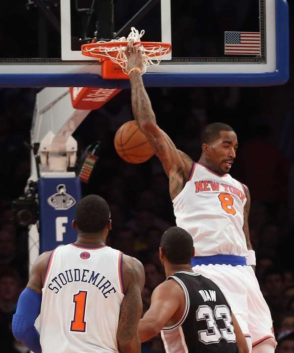 J.R. Smith dunks behind his head on a