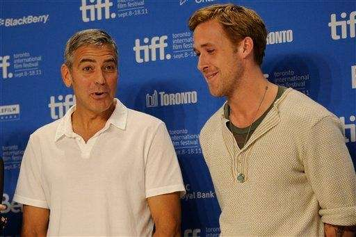 George Clooney and Ryan Gosling at a press