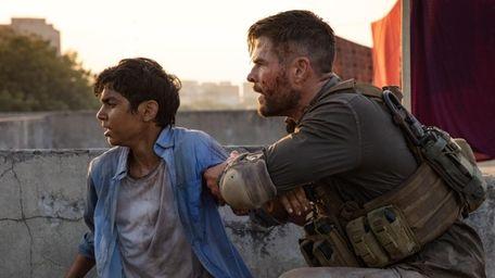 Rudhraksh Jaiswal (left) and Chris Hemsworth in Netflix's
