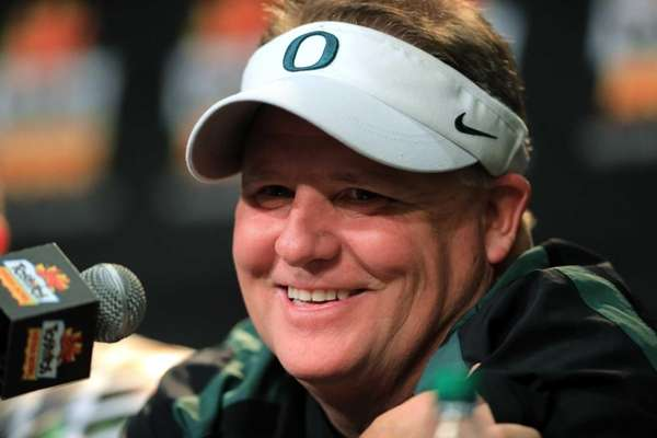 Oregon head coach Chip Kelly participates in a