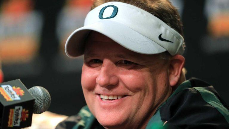 Oregon head coach Chip Kelly participates in a