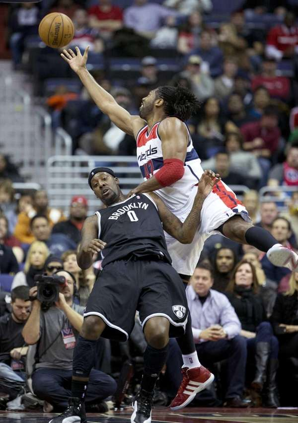 Washington Wizards center Nene (42) gets fouled by