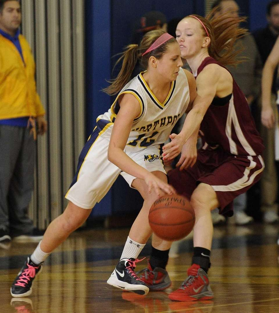 Northport's Allie Pavinelli drives around her Whitman defender.