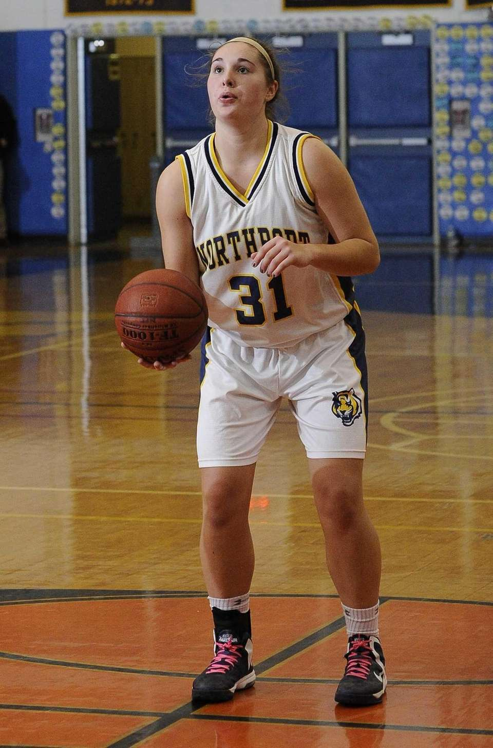 Northport's Dorrien Van Dyke sets up for her