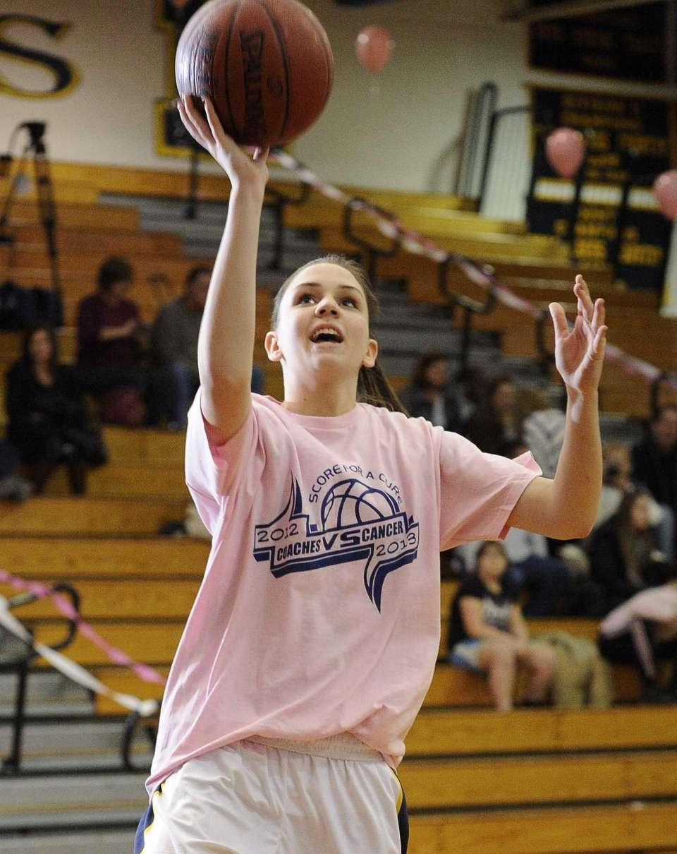 Northport's Kristin Cleary shoots during warmups wearing a