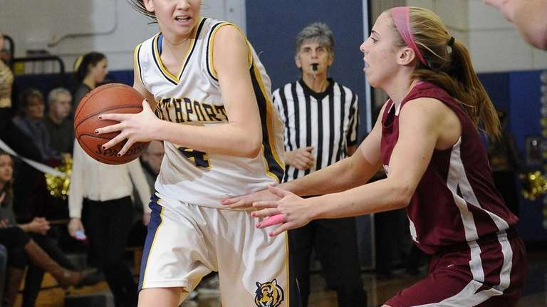 Northport's Kristin Cleary looks to drive past a