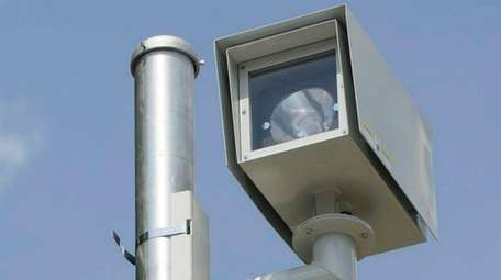 A speed camera clocks vehicles traveling south on