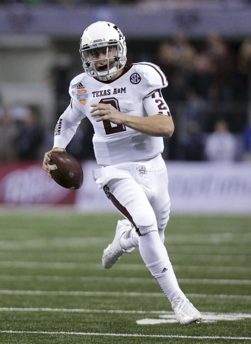 Texas A&M's Johnny Manziel finds running room against