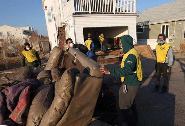 Volunteers from Mormon Helping Hands help clear out