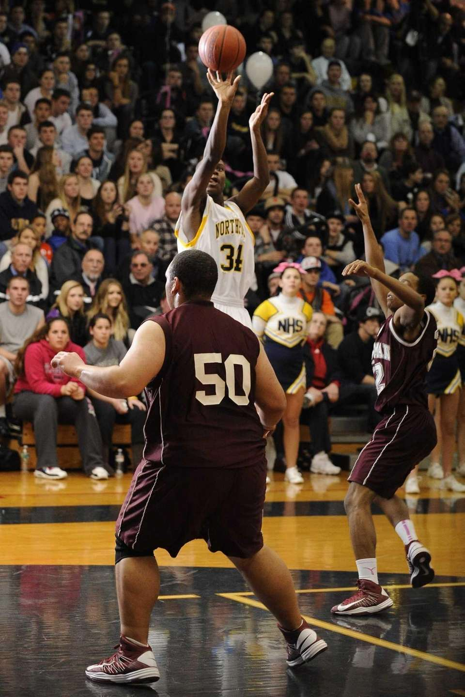 Northport's Michael Milligan Jr. shoots and scores during