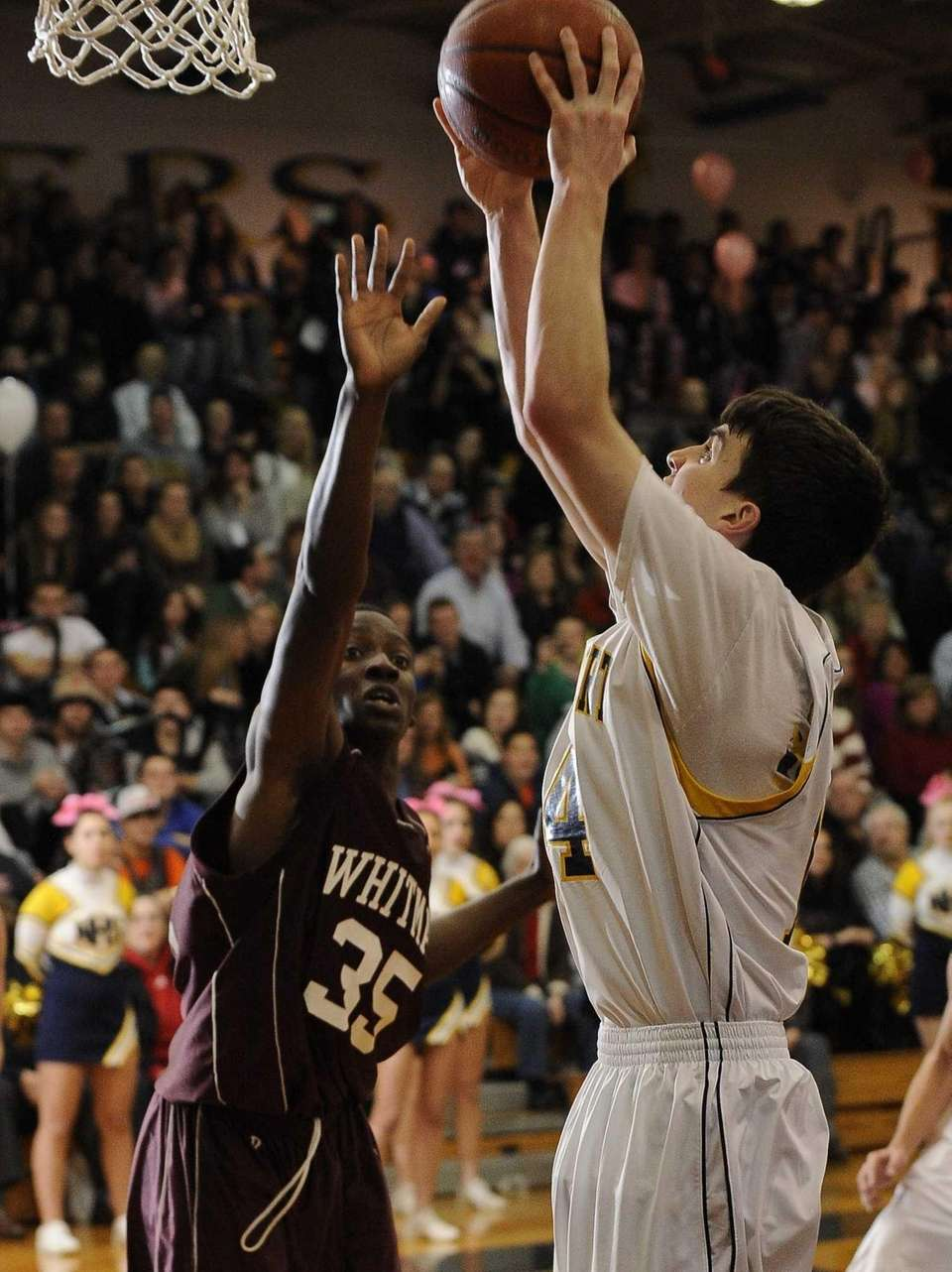 Northport's Thomas Kennedy shoots ahead of Whitman's K.B.