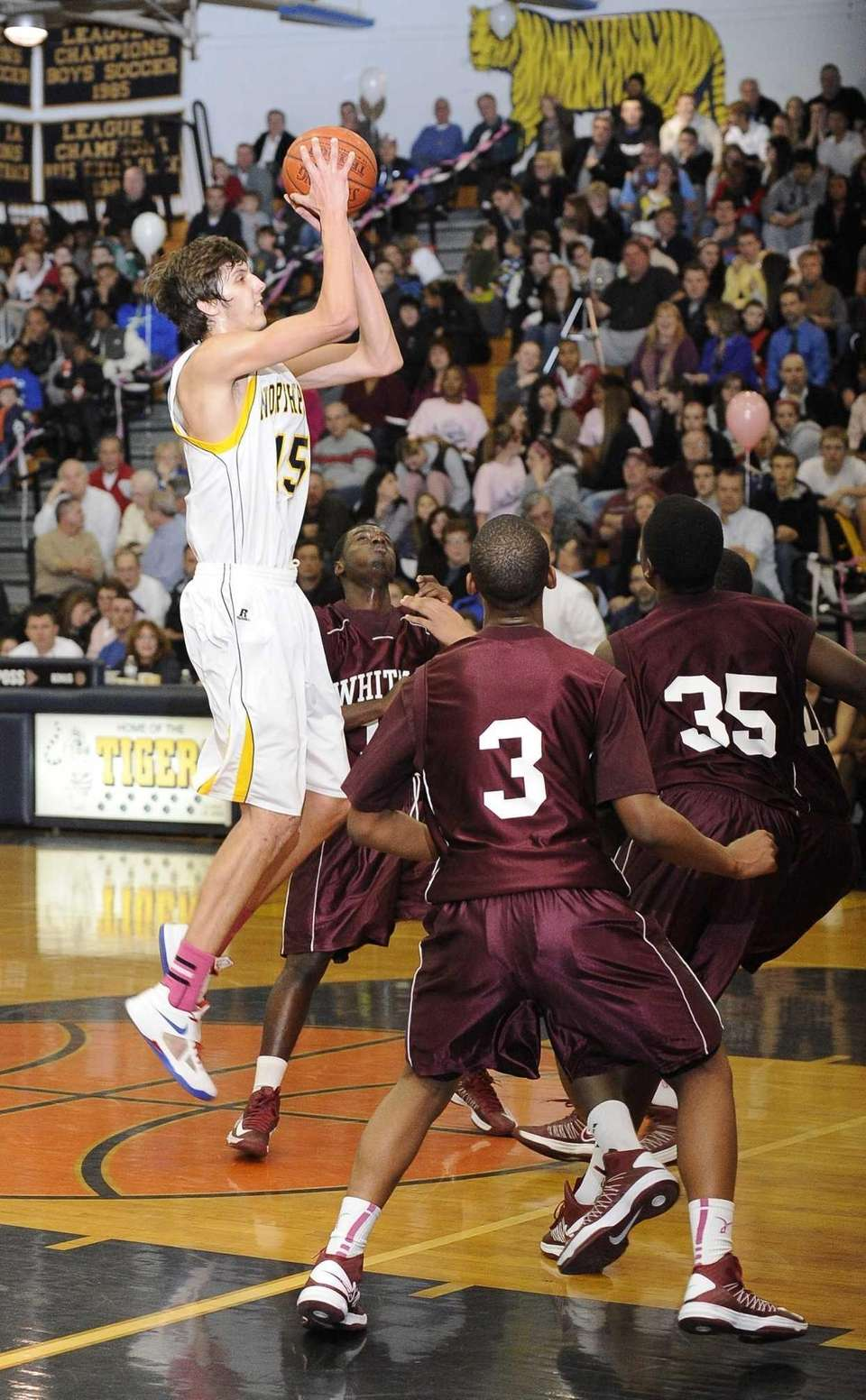 Northport's Luke Petrasek shoots over his Whitman defenders.