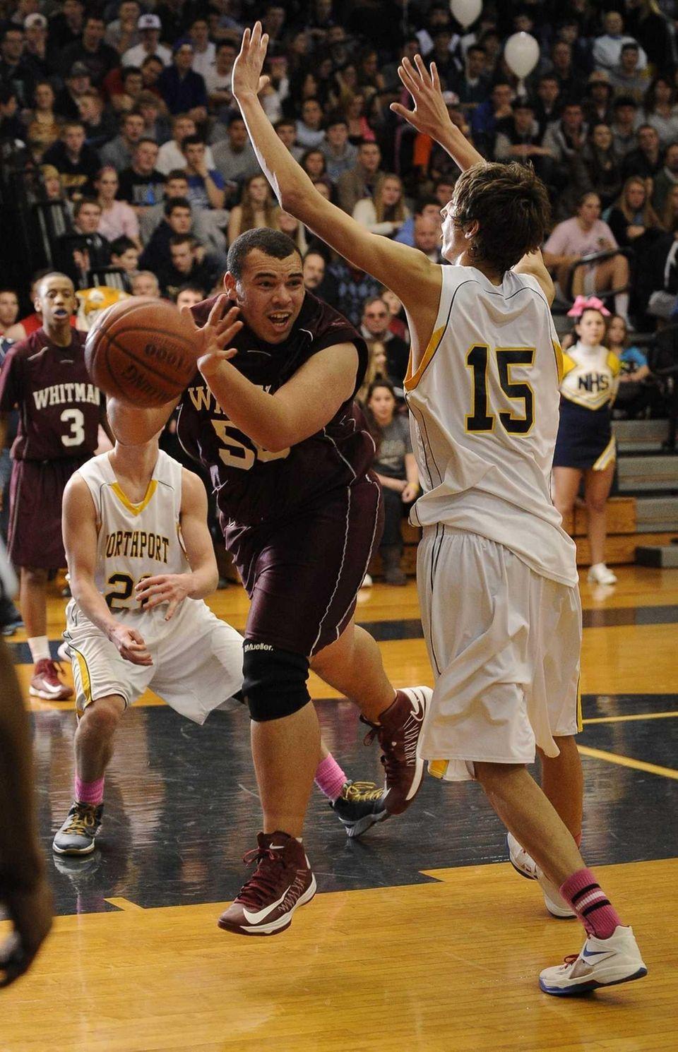 Whitman's Kieran Elmore passes the ball as Northport's