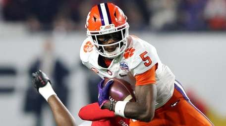 Tee Higgins of the Clemson Tigers carries the