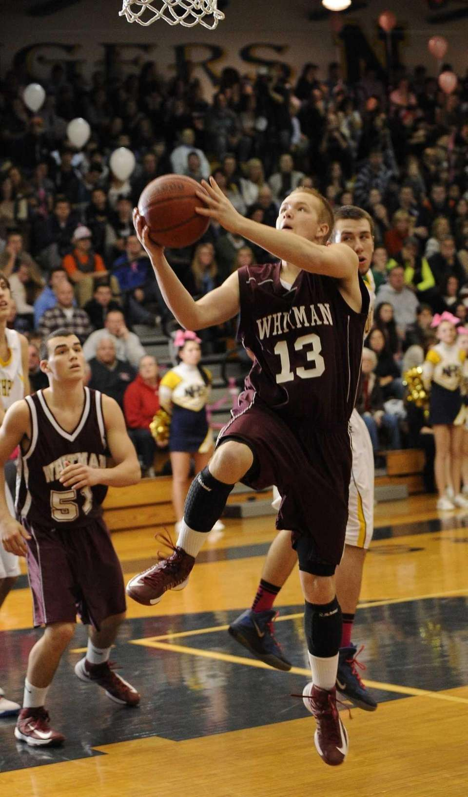 Whitman's Kevin Forland scores on a layup during