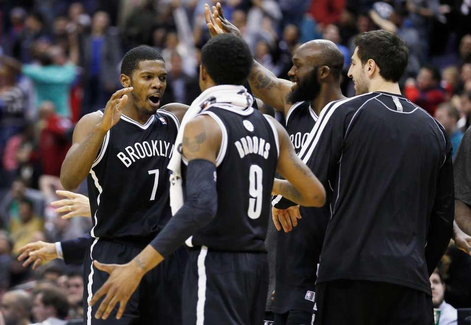 Joe Johnson celebrates with teammates after hitting the