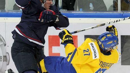 Filip Sandberg (R) of Sweden fights for the
