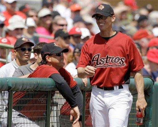 Former Houston Astros player Craig Biggio, right, walks