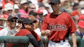 Former Houston Astros player Craig Biggio, right, walks
