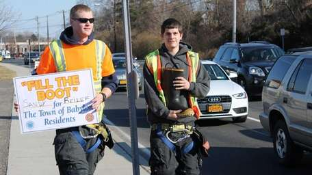 West Babylon residents and volunteer firefighters Brian Hammel,