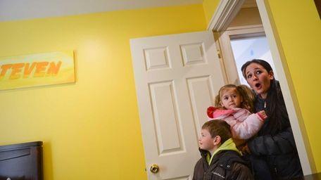 Steven, 6, Juliana, 3, and Danielle Heckman, are