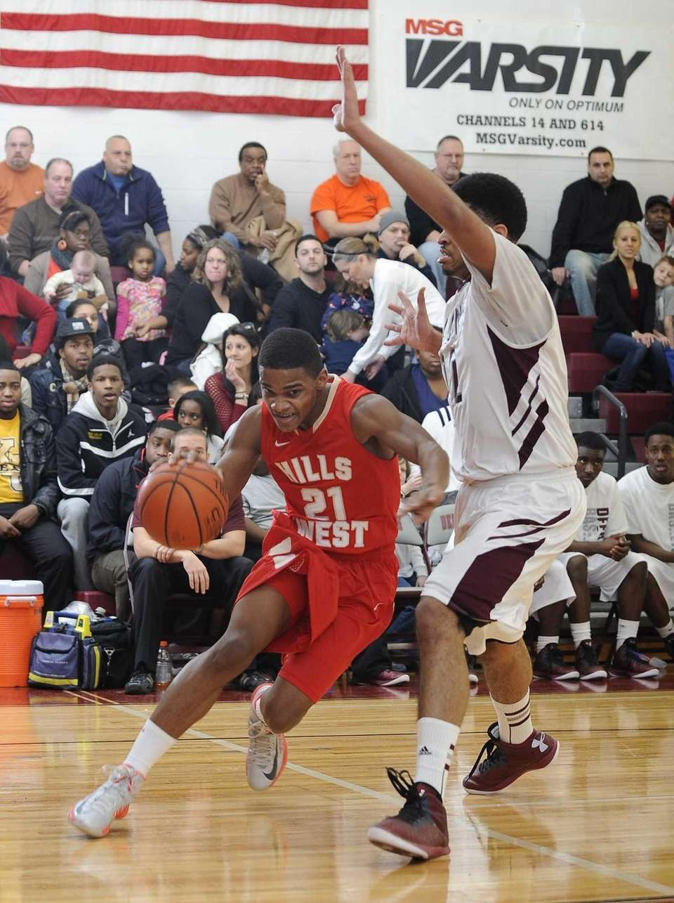 Half Holllow Hills West's Jamir Blackman drives past
