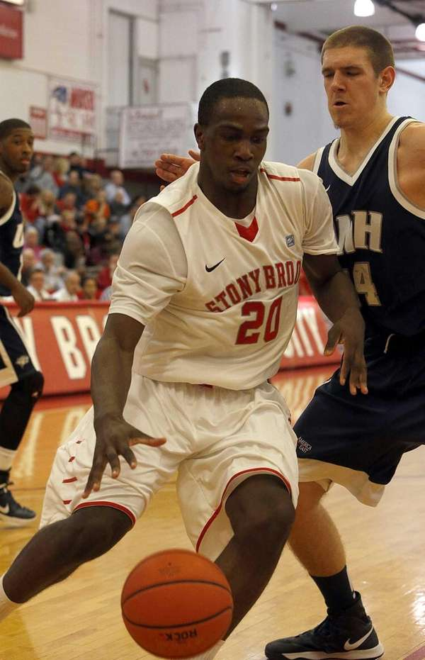 Stony Brook's Jameel Warney drives the baseline against