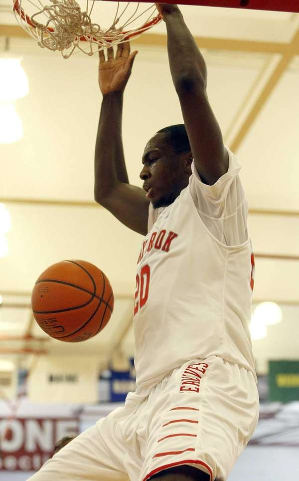 Stony Brook's Jameel Warney finishes off a pass