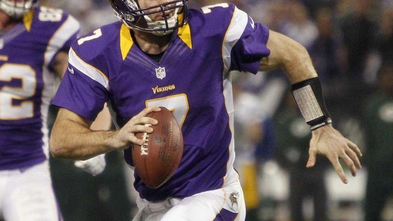 Minnesota Vikings quarterback Christian Ponder looks to pass