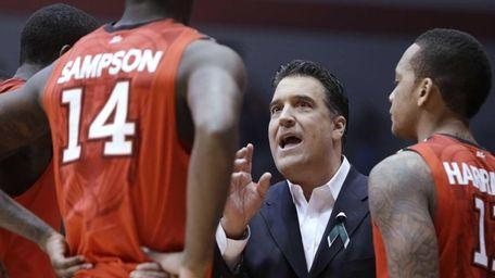 St. John's coach Steve Lavin talks with forward