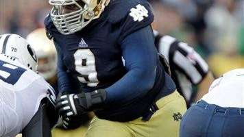 Notre Dame defensive lineman Louis Nix III rushes