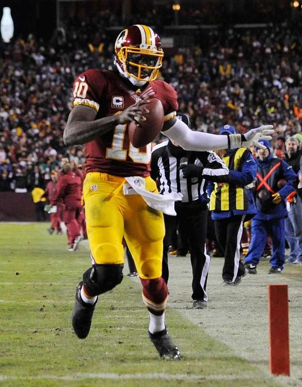 Washington Redskins quarterback Robert Griffin III runs the