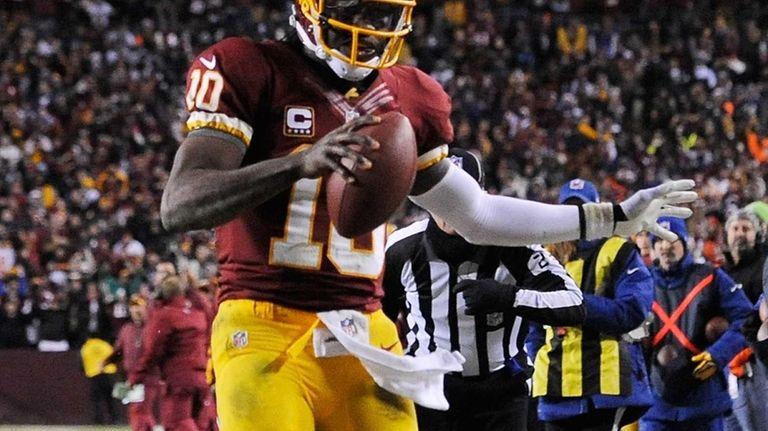 Washington Redskins quarterback Robert Griffin III runs the