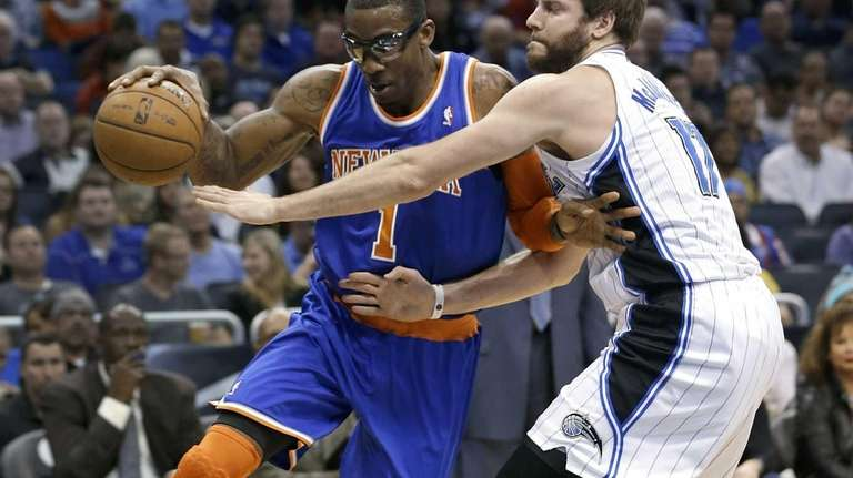 Amar'e Stoudemire, left, drives around Orlando Magic's Josh