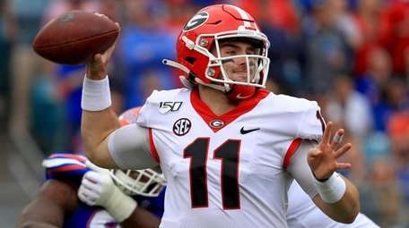 Jake Fromm of the Georgia Bulldogs passes during
