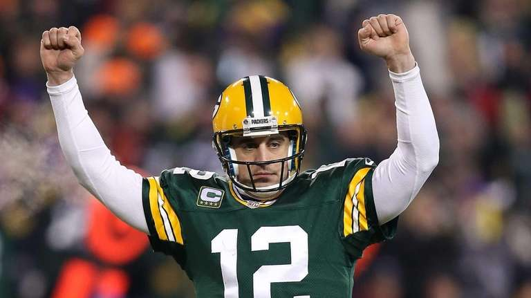 Green Bay Packers quarterback Aaron Rodgers celebrates after