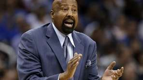 Mike Woodson encourages his team during a game