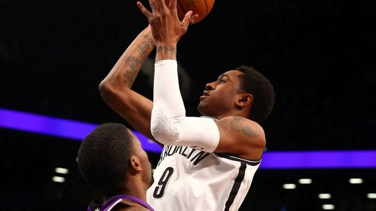 MarShon Brooks puts up a shot against the