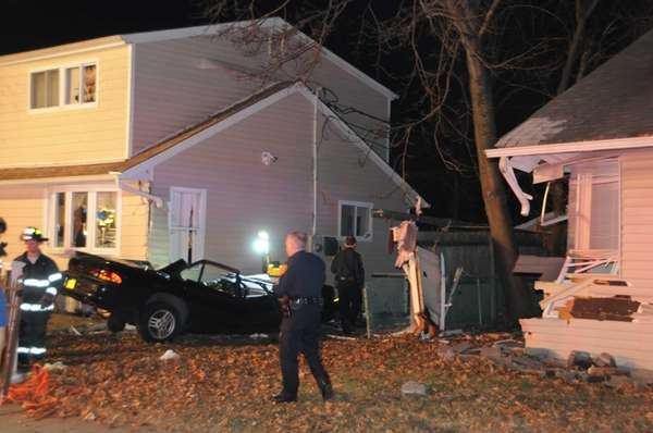 A Pontiac sedan crashed into two houses on