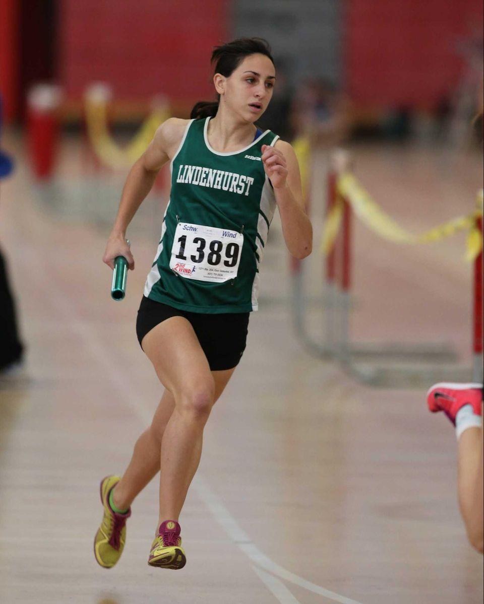 Bonnie Pisciotta runs the second leg of the