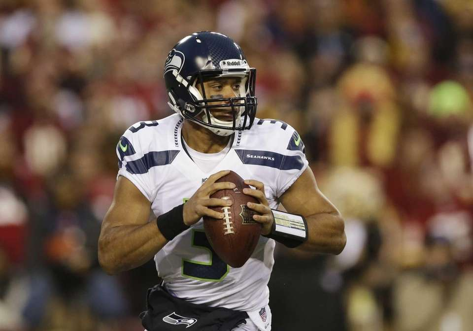 Seattle Seahawks quarterback Russell Wilson scrambles with the