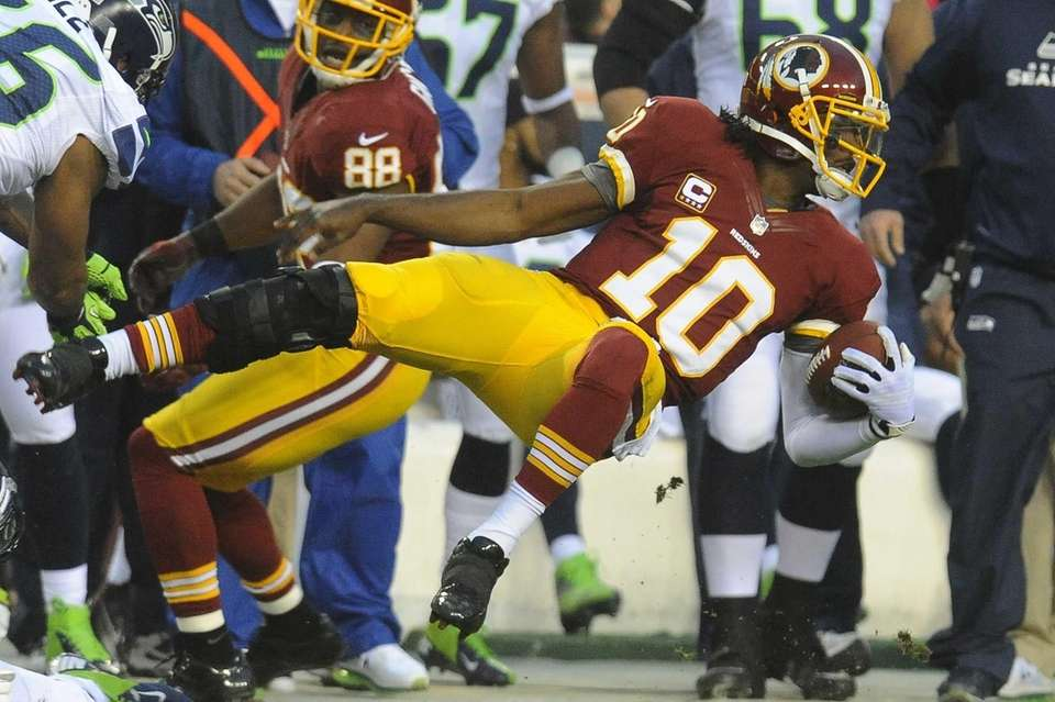 Washington Redskins quarterback Robert Griffin III flies through