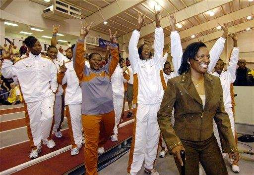 Texas women's coach Bev Kearney, front right, leads
