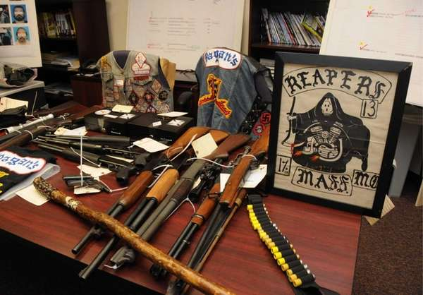 Guns and other weapons and belongings seized from