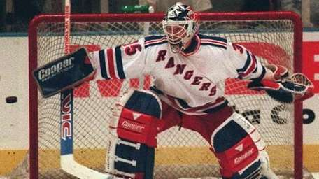 Mike Richter defends the net during second period