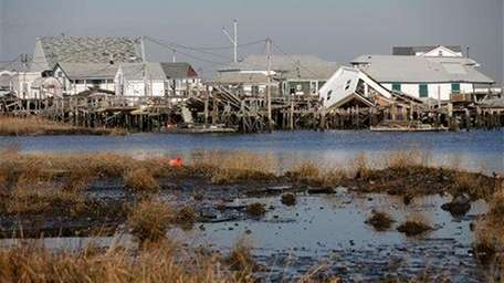 Homes and docks damaged by Superstorm Sandy remain