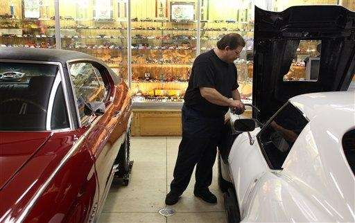 Perry Weaver works on a customer's 1968 Corvette