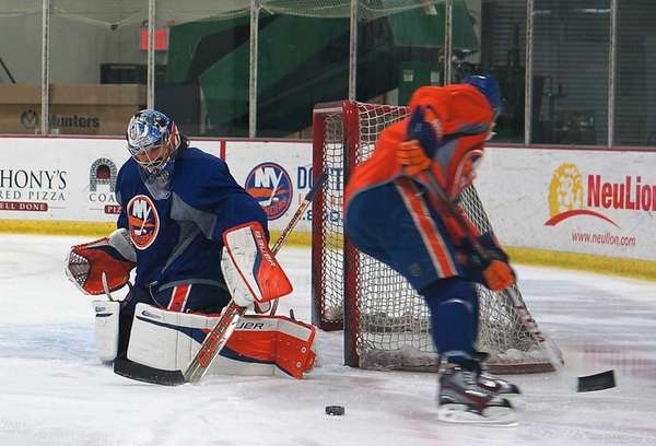 Islanders' Matt Moulson takes shots on goalie Rick