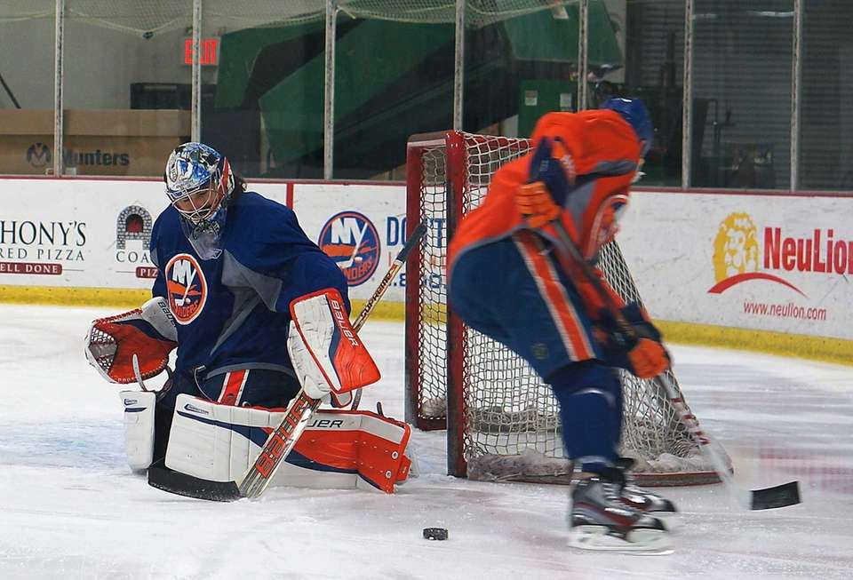 Islanders' Matt Moulson takes shots on goalie Rick